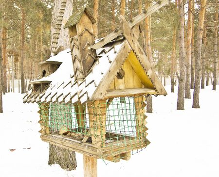big bird feeders in the winter in the woods, feeding trough for animals
