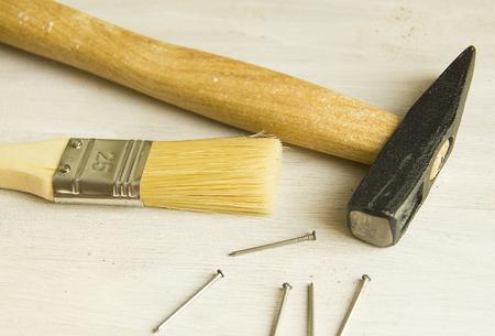 hammer and nails: hammer, nails, brush, tools for construction and repair Stock Photo