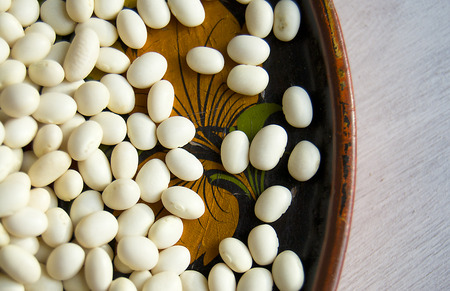 haricot: white beans in a beautiful wooden plate Stock Photo