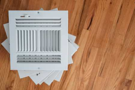 Registers, vents, air duct cleaning Stock Photo