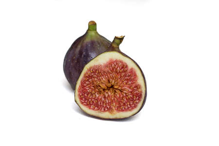 Two Ripe juicy figs isolated on a white background. Front View. One fruit in its entirety, the other photo in section