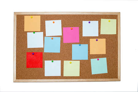 Concept of notes, goals, memo or action plan. Sticky notes on cork board in workplace office or home. Isolated on a white background. Copy space for text. Close up photo
