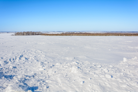 Snow-covered field in winter Stock Photo