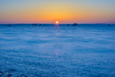 The appearance of the sun in the early morning above the horizon