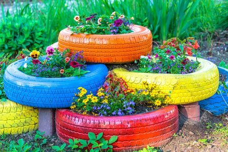 Painted tires being used for a flower planter.