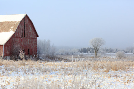 An old barn and snow on an early winter day in Wisconsin.
