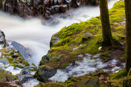 Moss and flowing water of the dells of the eau claire in Aniwa, Wisconsin, horizontal