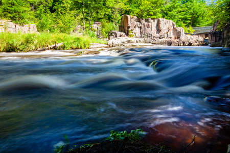 Eau Claire River running through the Dells of the Eau Claire Park in Aniwa, Wisconsin, horizontal