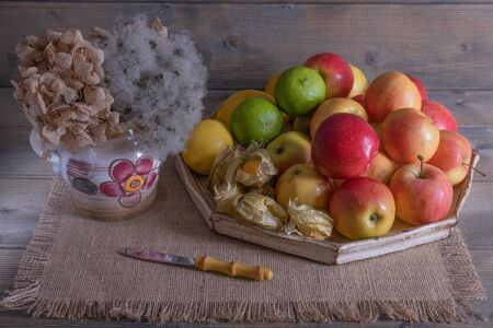 apples on a tray and flowers