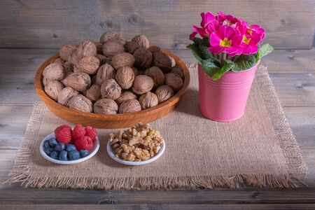 walnuts with berries and flowers 版權商用圖片