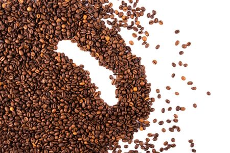 coffee grain made from many whole coffee beans on a white background