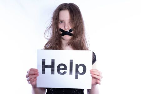 girl with a closed mouth asks for help on a white background
