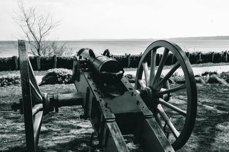 black and white photo, an ancient cannon that shoots with cores rear view, in spring Stock Photo