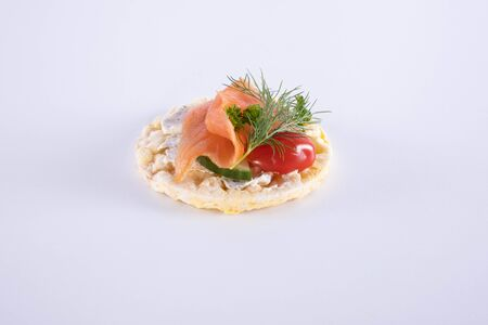 salmon tomato and dill on a corn waffle on a white background
