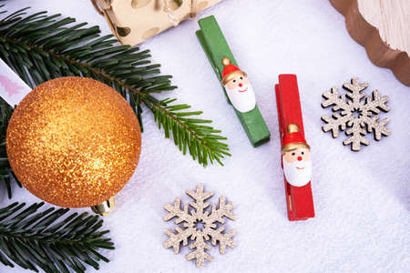 Christmas tree decorations, holiday decorations, lie on the table on a white background