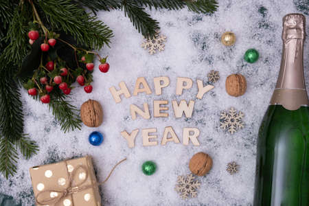 """champagne, red berries, and the snow says """"Happy New Year"""" on a white background"""