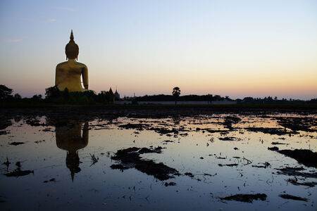 Giant buddha in Angthong province at sunrise, Thailand Stock Photo - 23473210