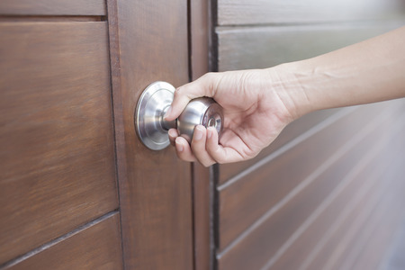 hand hold handle of wood door  photo