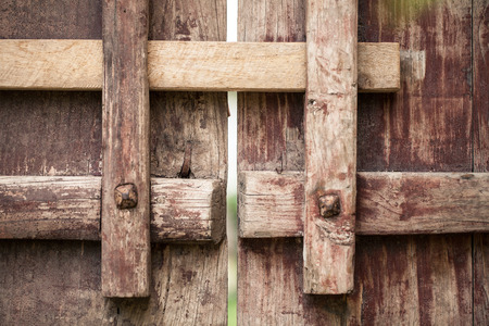 Locked brown latch and door  Stock Photo - 29428176