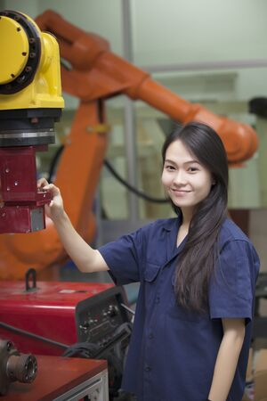 Manufacturing worker operating a robot machine  photo