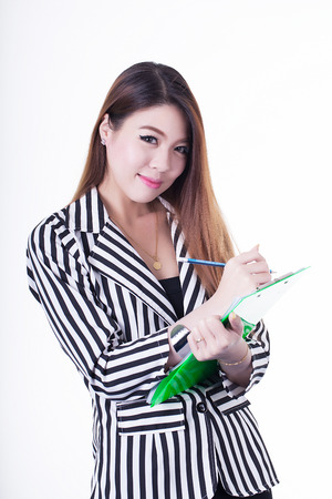 Asian business woman writing note on a clipboard photo