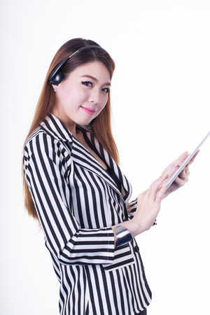 ibook: Asian business woman in New using and earphone