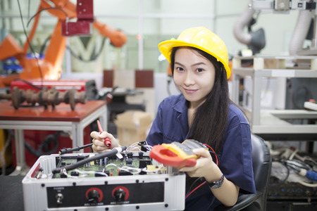 Young scientist tests electronic equipment  in laboratory Stock Photo