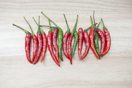 trencher: Red chili pepper on the wooden trencher