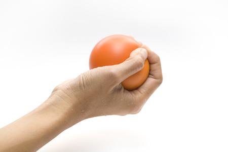 stress ball: Hand squeezing a stress ball