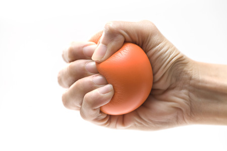 stress ball: Hand squeezing a stress ball