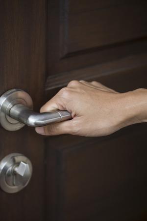 handle: hand hold handle of wood door
