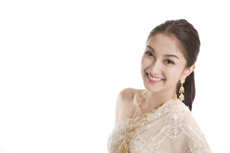 Portrait of Thai young lady in an ancient Thailand dress with isolated background. photo