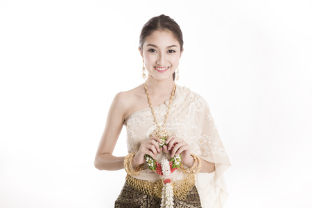 Young Thai lady in traditional costume holding garland isolated background photo