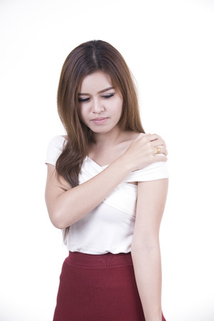 working stiff: Woman has shoulder pain Stock Photo