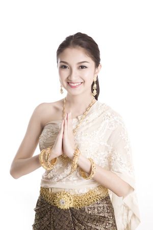 Thai women welcome with traditional Thai suit in Studio Stock Photo