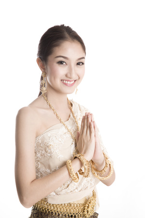 Thai women welcome with traditional Thai suit in Studio 版權商用圖片