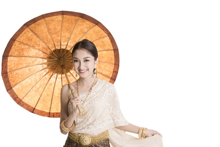 Asian women holding paper umbrella and smile with white background photo