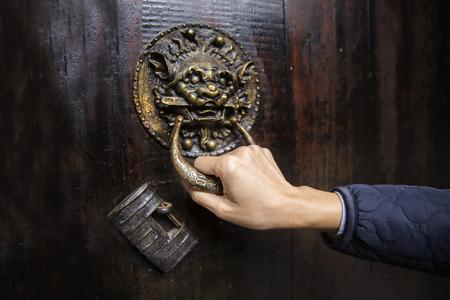 hand holding a door handle photo