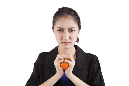 stress ball: businesswoman in stress squeezing a stress ball