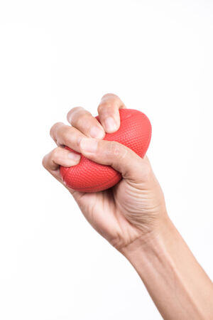 squeezing: Hands of a woman squeezing a stress ball