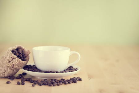 cup  coffee: Coffee cup on the table- vintage style effect picture Stock Photo