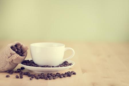 taza cafe: Taza de caf� en el cuadro efecto estilo vintage mesa-
