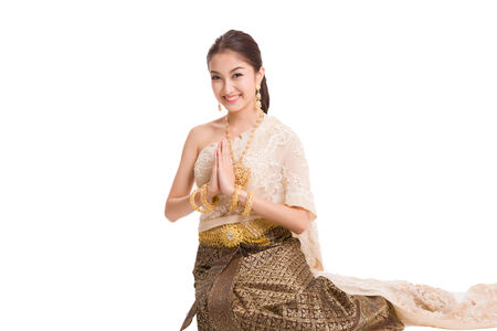 thai: Thai women welcome with traditional Thai suit in Studio Stock Photo
