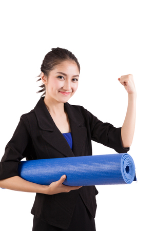 excercise: Young beautiful business woman holding a yoga mat preparing the excercise Stock Photo