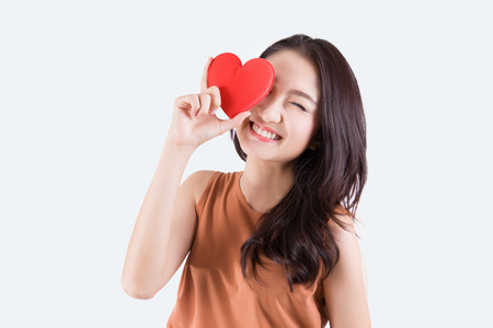 girl holding sign: Woman holding heart Stock Photo
