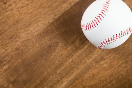 infield: A baseball on wood table Stock Photo