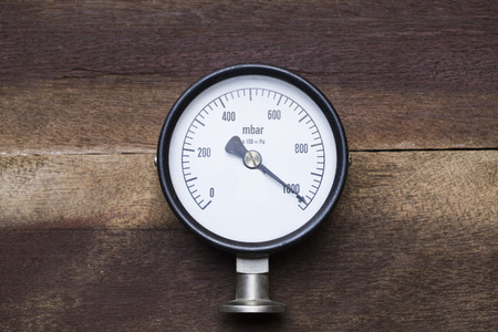 pressure gauge on wood background