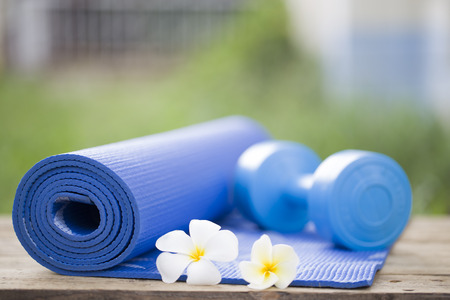 workout gym: yoga mat and a dumbbell Stock Photo