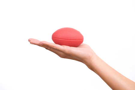 stress ball: Hands of a woman holding a stress ball on white background