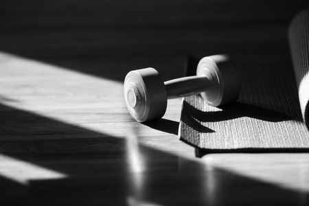 heavy weight: dumbbell near the window, black and white concept